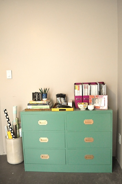 Bright colored dressers and filing cabinets really brighten the room.