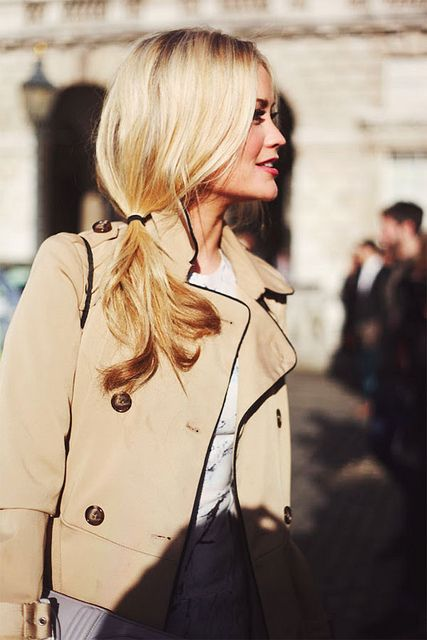 Side ponytail + trench coat.