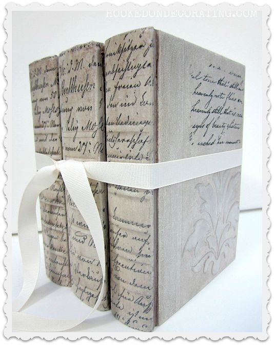 "BOOK CRAFTS :: DIY Tutorial: Make cheap vintage books into beautiful books with paint, stencils & clip art images! :: this would also be a good idea to do on those ""hide-a-way"" dictionary diversion safes you can find on amazon...to make a pretty vessel for your treasures. :: hookedondecorating.com 