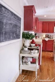 loving the red cupboards,a baking table at the wall where my fridge is with a chalkboard there with the recipes i need and under the table can be all the storage for my baking,oh how my mind is brainstorming but with black and white decor what can i paint my walls? any ideas