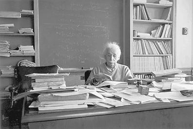 "Albert Einstein at his desk: ""If a cluttered desk signs a cluttered mind, of what, then, is an empty desk a sign?"" #writers #workspace #einstein"