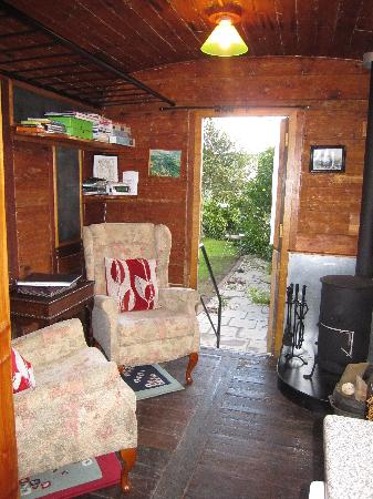 Railholiday - The Old Luggage Van and The Travelling Post Office: The sitting area comes complete with a woodburning stove - all logs provided!