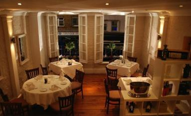 A professional image of the interior of the restaurant in London known as About Thyme