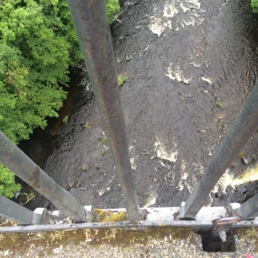 Image result for looking down between boards to the river
