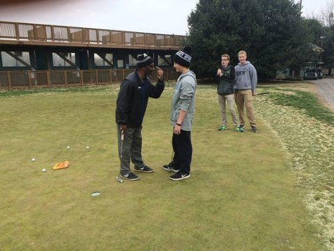 Coach Chain teaching the game of golf   Picture of East Potomac Golf     East Potomac Golf Course  Coach Chain teaching the game of golf