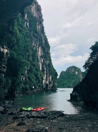Caving in Vietnam: Two kayaks are on the shore of Vietnam's Trinh Nu Cave.