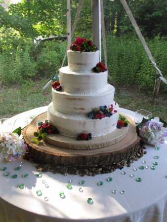 Rustic semi naked wedding cake with fresh fruit and sugar flowers     Cakes For All Occasions  Rustic semi naked wedding cake with fresh fruit  and sugar