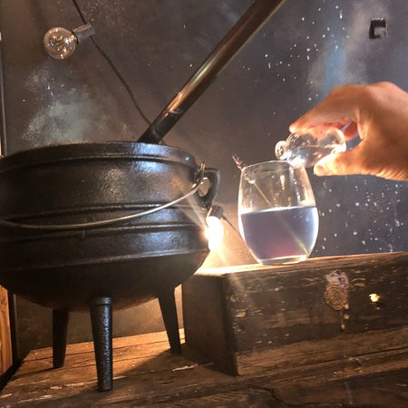 Cauldron and cocktails being mixed