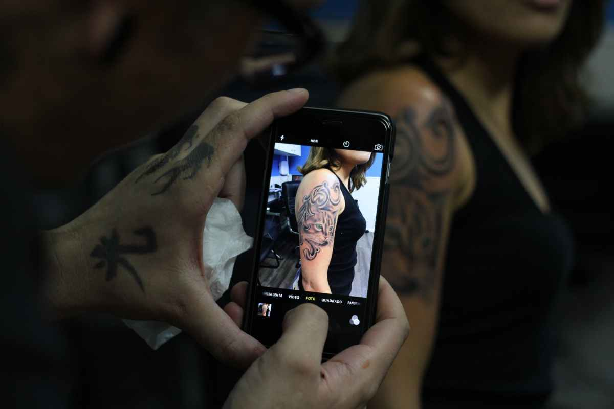 taking a photo of a tattoo