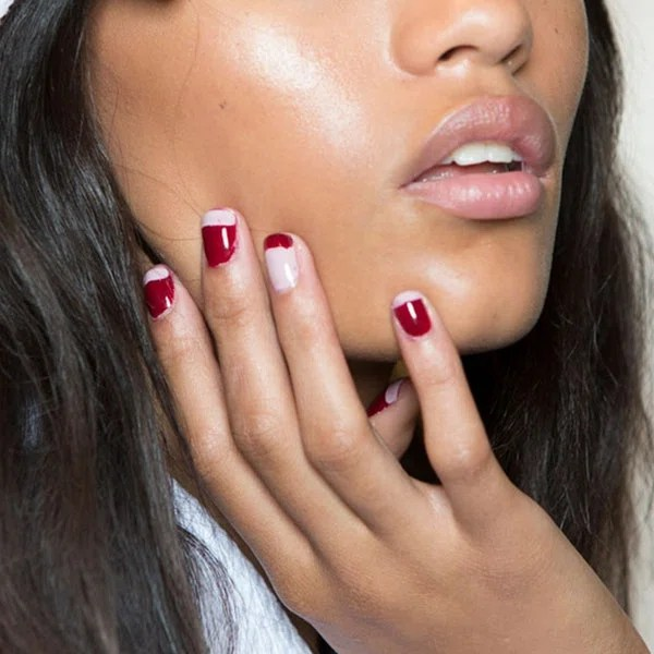 A subtle, blink-and-you'll-miss-it homage to the accent nail, the swapped colors on each ring finger were a playful addition to the dual-toned mani at Rebecca Minkoff. Obsessed with the crimson and beige pairing here? Get it for yourself with Essie Maki Me Happy and Essie Go Go Geisha.