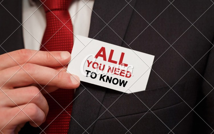Businessman putting a card with text All you need to know in the pocket