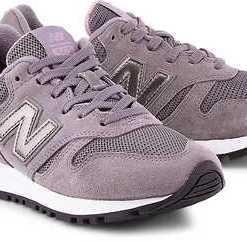 Retro-Sneaker 565 von New Balance in lila für Damen. Gr. 38