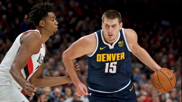 Nikola Jokic powers Nuggets past Portland in season opener