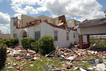 The upper walls of this house were blown to the ground.