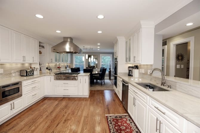 Kitchen With White Granite Countertops And Stainless Steel