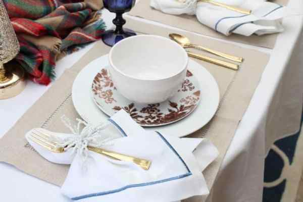 Gold silverware adds some sparkle to a holiday table. (Photo by Rebekah Dempsey/A Blissful Nest)