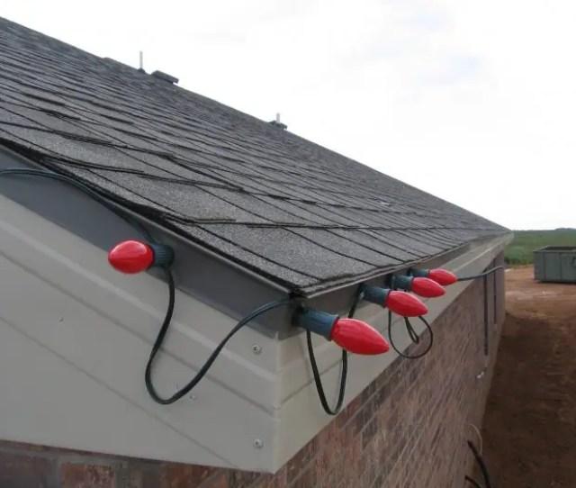 Magnetic Christmas Lights Stuck To Metal Edge Of Roof