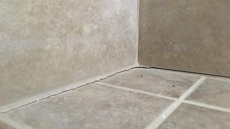 Avoid Cracked Grout  Caulk Tile Shower Corners   Angie s List Avoid Cracked Grout  Caulk Tile Shower Corners