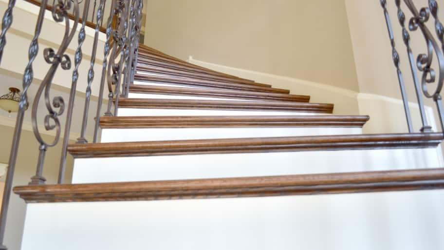 Transform Your Staircase Into Something Grand Angie S List | Two Tone Wood Stairs | Timber | Partially Carpeted | White Back | Diy | Rug