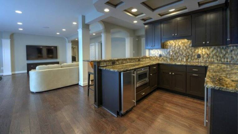 Pro Tips for Building an In Law Suite   Angie s List in law suite  finished basement  kitchen  wood floors