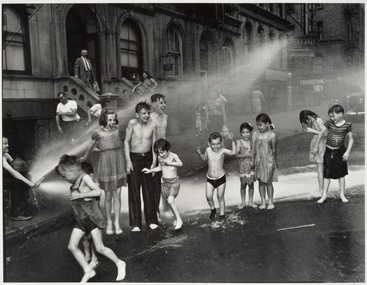"""Summer on the Lower East Side"" by Weegee (Arthur Fellig), gelatin silver print, 31.8 x 41.4 cm (12 1/2 x 16 5/16 in.), 1937. © Weegee / International Center of Photography."