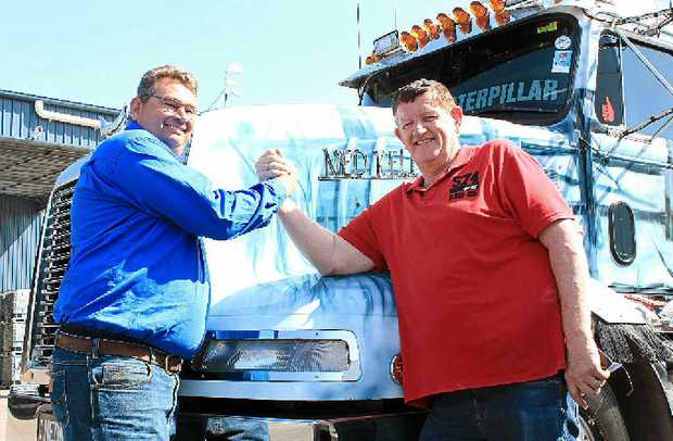 ARM WRESTLE: It was a race to see who would lead last year's Brisbane Convoy for Kids. In a hard-fought battle Scuzzy (Andrew McSweeny left) conceeded to Barry Land the night before the convoy. (Sean Owensbig Rigs)