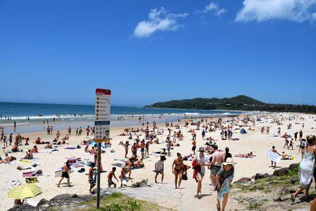 Crowds flock to Main Beach, Byron Bay.