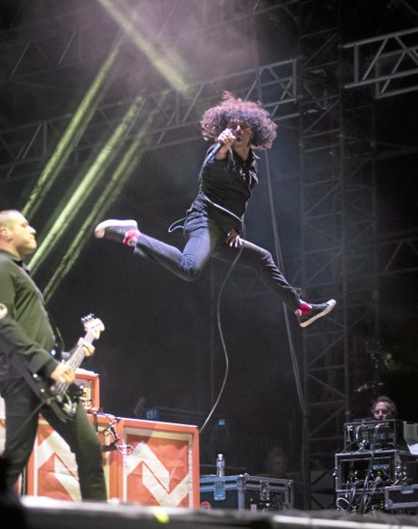 At The Drive In front man Cedric Bixler-Zavala up in the air during their Splendour in the Grass 2016 show.