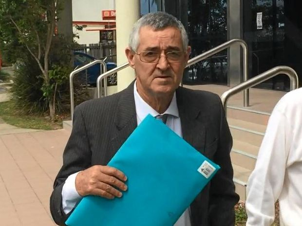 Philip James Russell, 61, leaves Maroochydore Court House after pleading guilty to assaulting a flight attendant when in the air between Bangkok and Sydney.