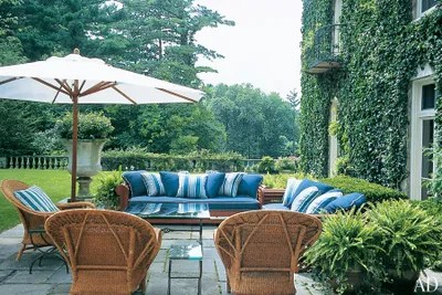 the rear terrace of ralph and ricky laurens ivycovered home in bedford new york features relaxed