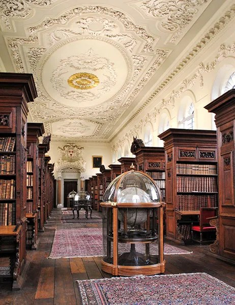 The architect of the Queen's College Library at Oxford University, built between 1692 and 1695, is unknown, but research suggests that credit should go to Henry Aldrich, the then-dean of Christ Church, who designed other buildings in Oxford, or Timothy Halton, the provost of the Queen's College at the time the library was built.