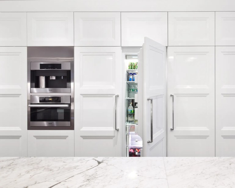Image may contain Indoors Room Appliance Shelf and Kitchen