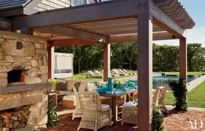 a pergola can have all the comforts of the indoors from sofas to fireplaces under