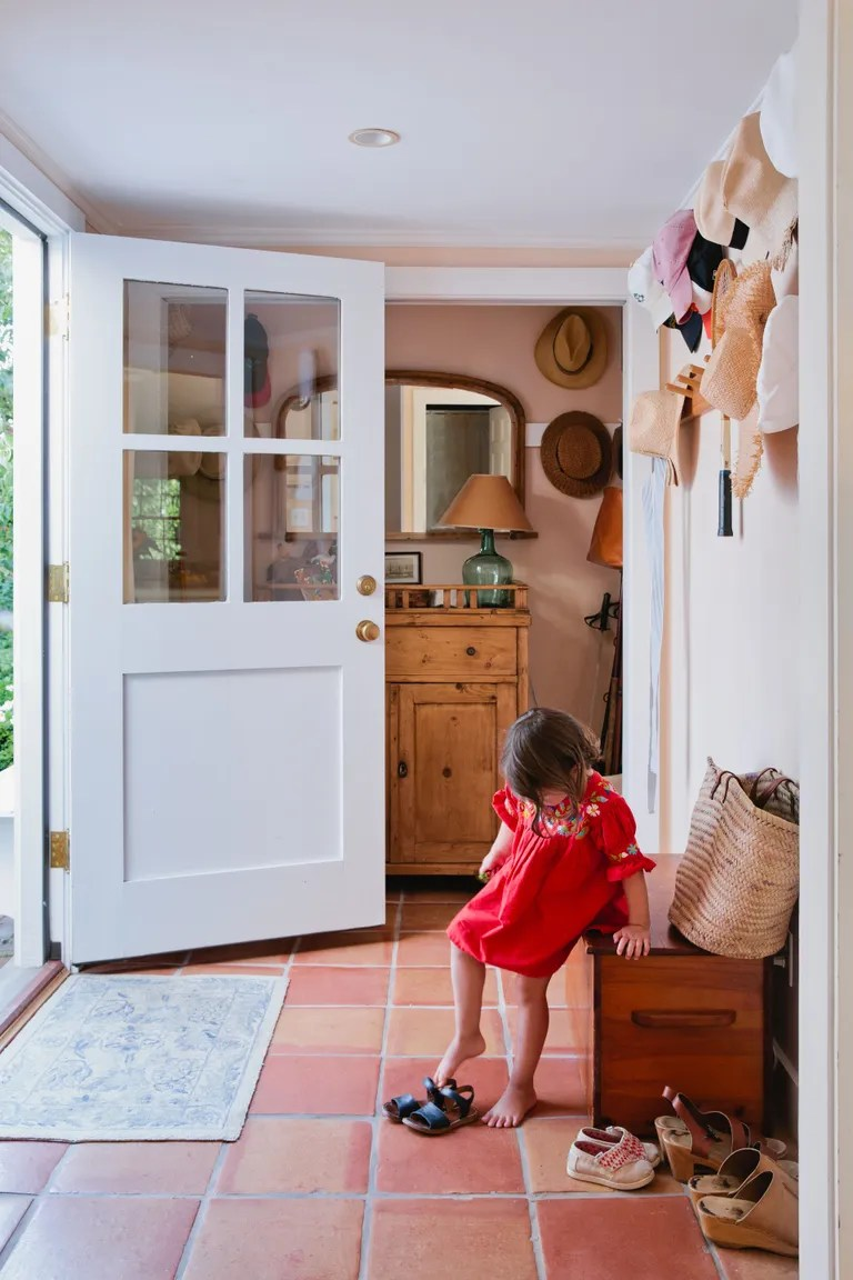 A Classic Cape Cod Saltbox with a Modern Twist   Architectural Digest Schelter s daughter Charlotte steadies herself on an antique Scandinavian  cupboard from Design Works Cape Cod