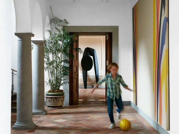 An Isamu Noguchi sculpture stands beyond the entry corridor. Painting by Morris Louis.