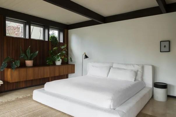 bedroom with big white platform bed