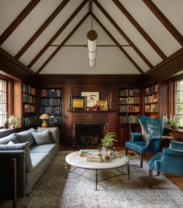 The library beckons afternoon cocktails with a pair of brightly colored wingbacks from Anthropologie; Neri&Hu's Frame sofa for De La Espada sits opposite. The mantle plays host to works by a bevy of local artists, including Sandee Burman, Tom Hardy, and Yvonne C. Branchflower.