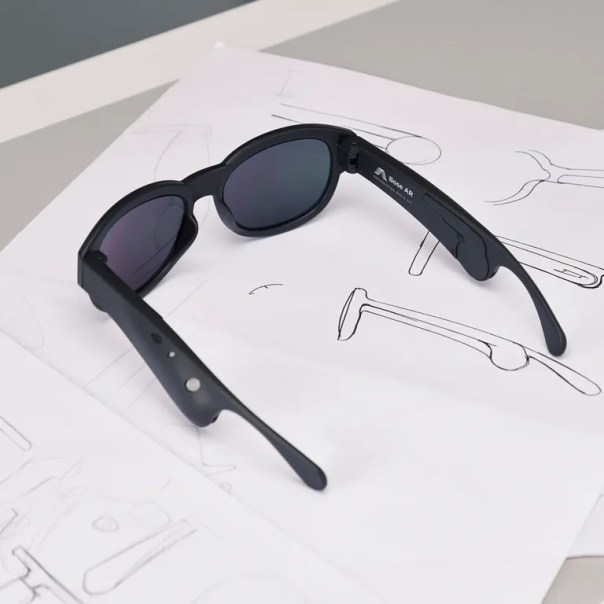 The sunglasses, while slightly bulkier than a traditional pair, only weight TKTK grams (for comparison, the average Ray Ban weighs between 30 and 40 grams).