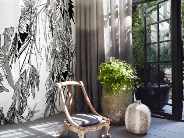 A wall mural by Swoon and a chair sculpture by JamesPlumb converse in the stair hall.