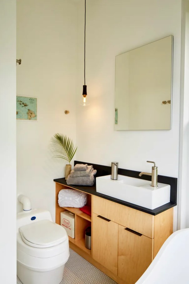 a small bathroom with a toilet and sink.
