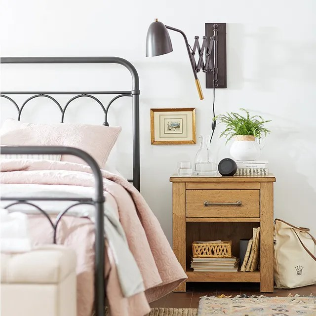 The 35 Best Amazon Prime Day 2018 Deals on Home Decor Photos     bedroom with wrought iron bed  extendable sconce  and pink linens