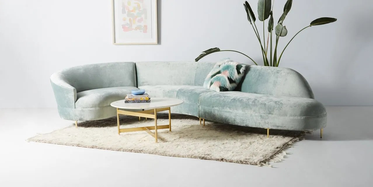 a curved sofa architectural digest