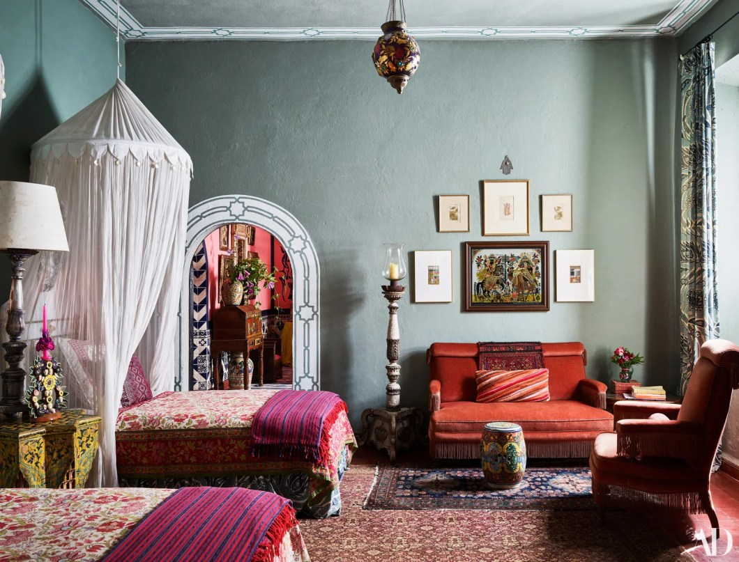A guest room features painted motifs custom bedspreads Fez pillows and bed skirts all by Nussbaumer. Canopy by Wisteria...