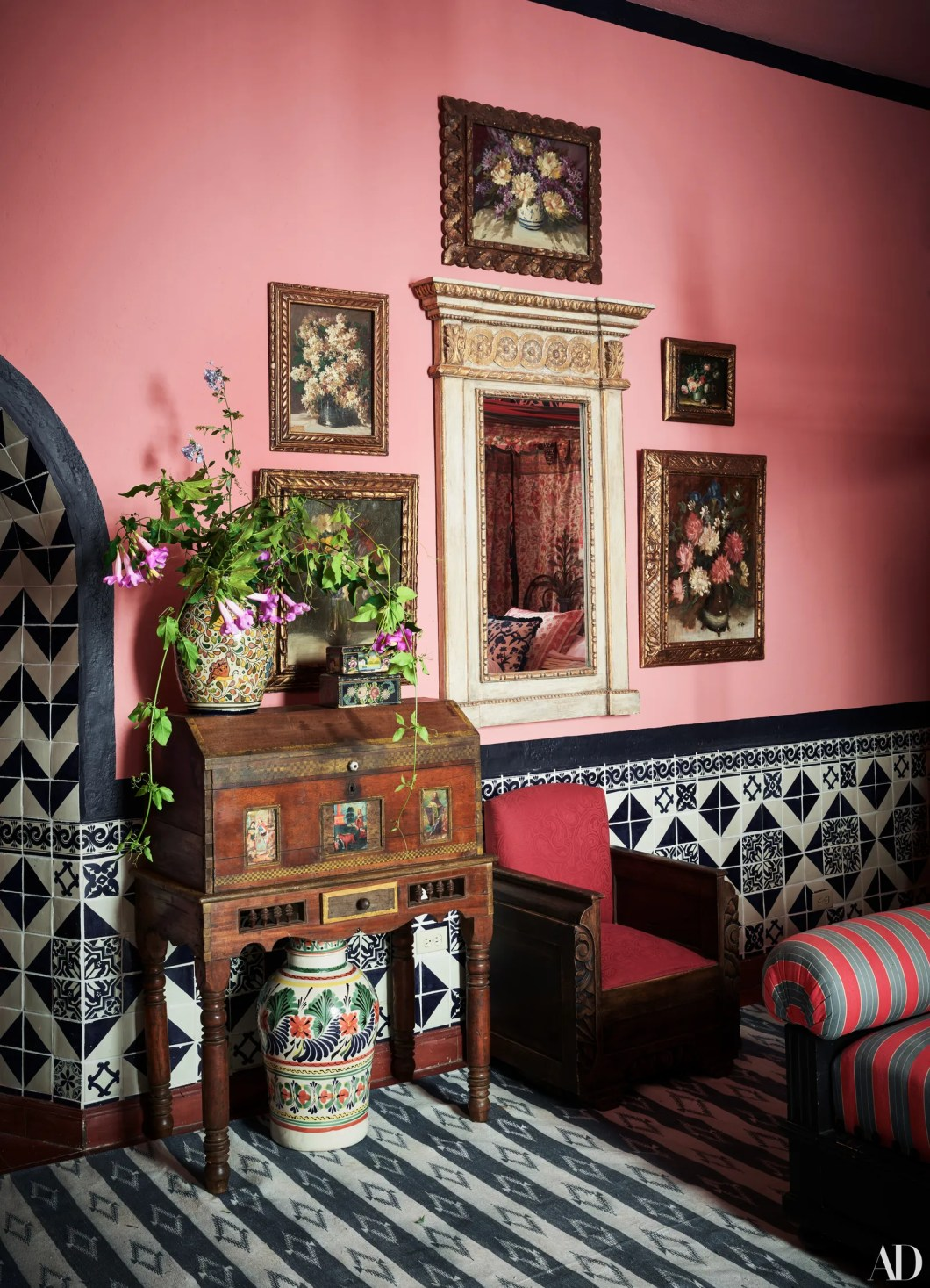In Nile's bedroom still lifes by Nussbaumer's mother Barbara StephensDunlap surround a mirror from Ceylon et Cie....
