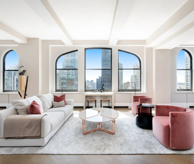 A White Living Room With A Pink Couch And A White Couch