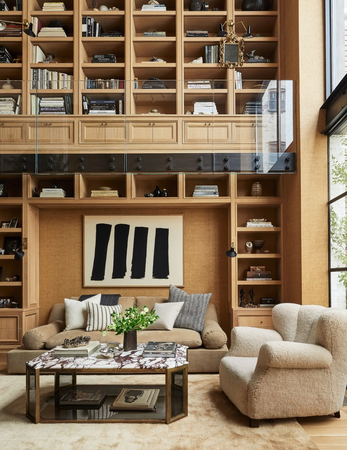 the living room with wood paneling