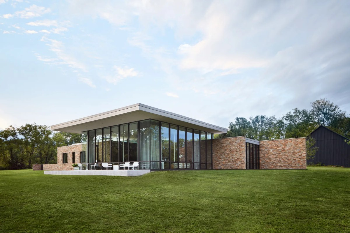 pLandscape architect Michael Boucher helped ARO orient the property to overlook the meadow and creek. Beyond the great...