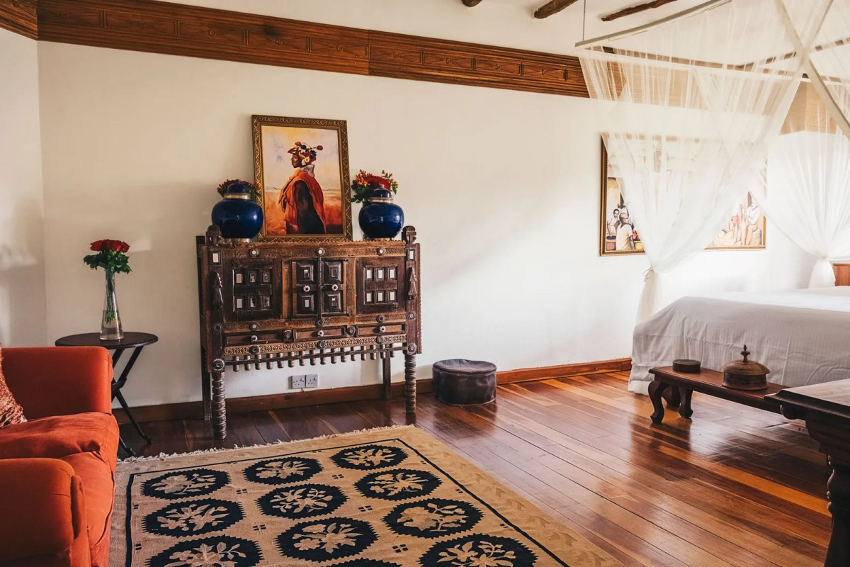 Image may contain Flooring Floor Wood Hardwood Living Room Indoors Room Rug and Interior Design