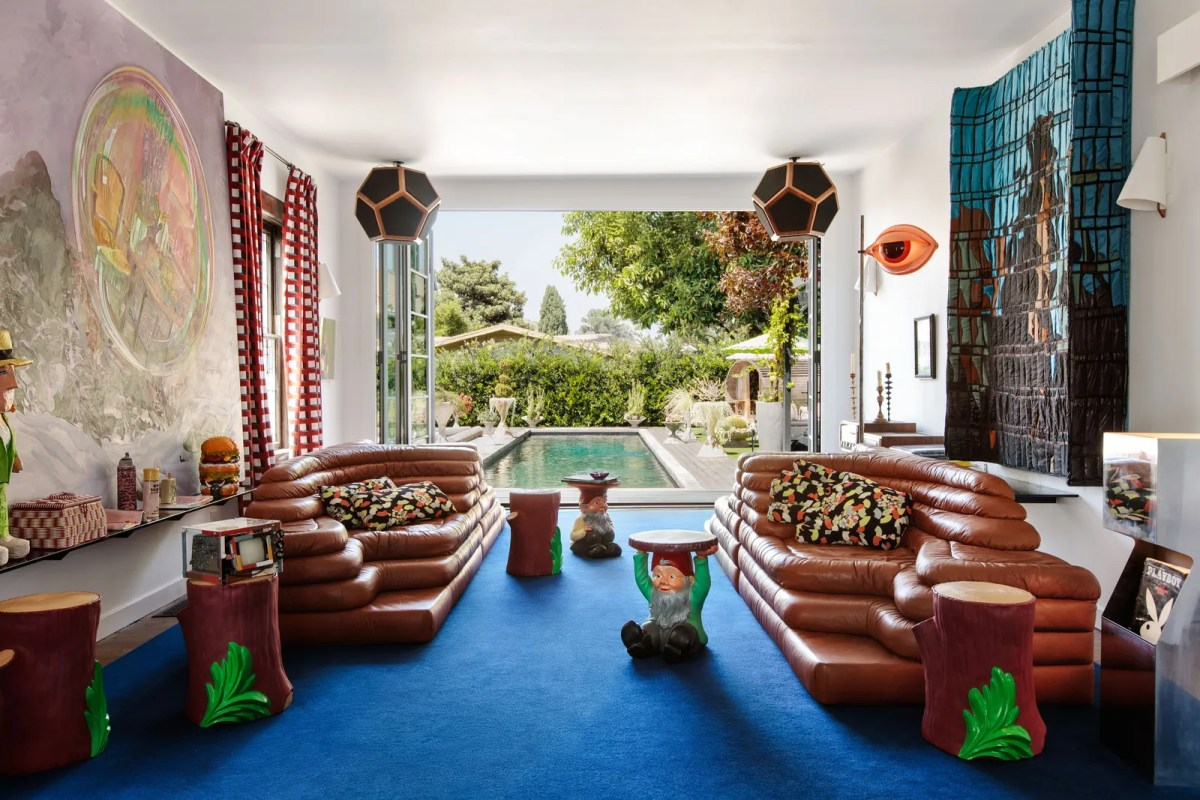 A colorful living room with blue carpet