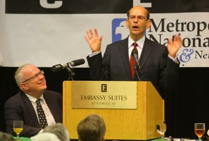 Talk-show host Paul Finebaum of Birmingham, Ala., speaks to the Little Rock Touchdown Club on Monday in Little Rock. Finebaum says the right coach can rejuvenate Arkansas' football program.